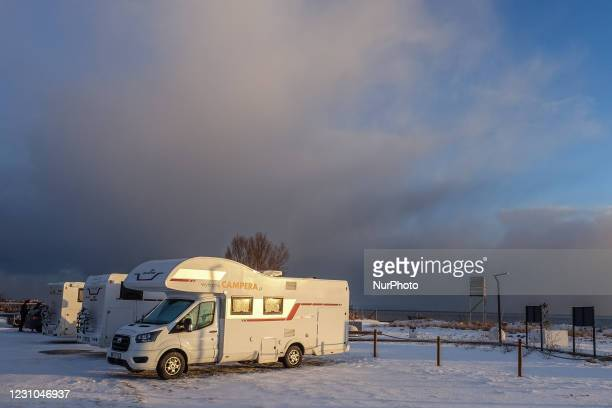 Motorhomes parked by the sea are seen in Mechelinki, Poland, on 6 February 2021 Due the -19 restrictions hotels in Poland remain closed until 12th of...