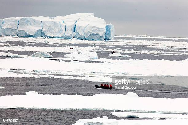 "Motoring on the Weddell Sea the tourists come nearer to landing on the ice shelf of Antarctica during a voyage to Antarctica on a ship called ""Le..."