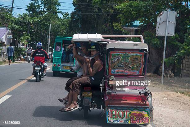 A motorised three wheeler public transport vehicle with a full complement of passengers Cebu City Cebu Province Philippines