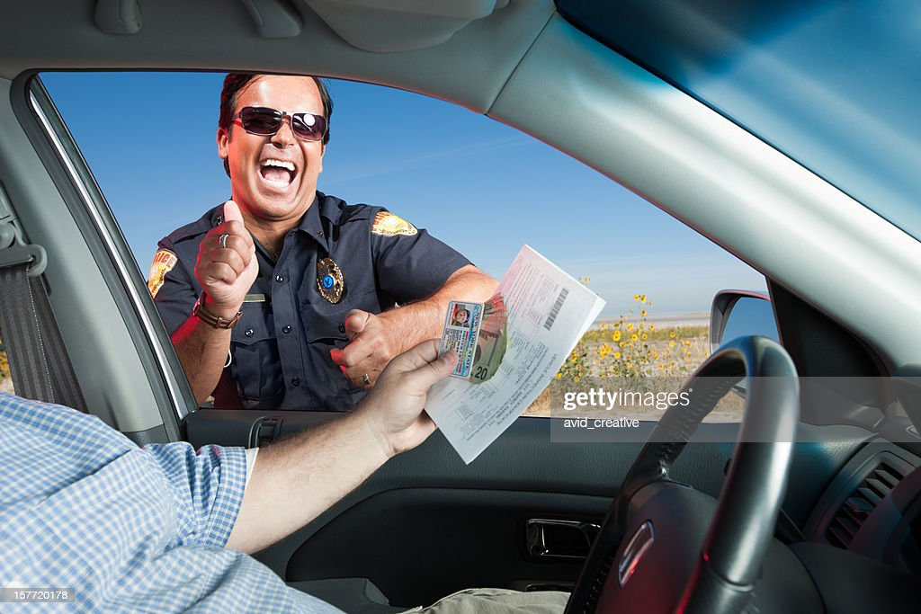 Motorist Bribing Traffic Police Officer : Stock Photo