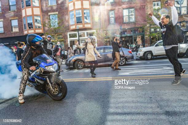 Motorist burns rubber to intimidate Black Lives Matter activists at a protest against the police killing of Ma'Khia Bryant, while a Black Lives...