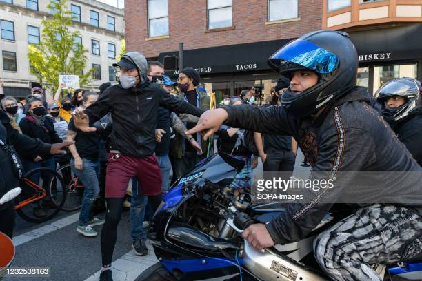 Motorist burns rubber to intimidate Black Lives Matter activists while he turns around at a protest against the police killing of Ma'Khia Bryant....