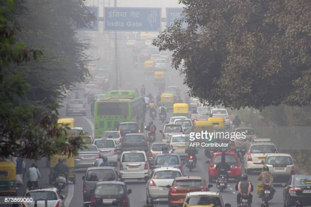 Motorist drive amid heavy smog in New Delhi on November 14 2017 Doctors declared a public health emergency in New Delhi when choking smog descended...