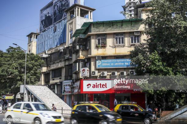 Motorist drive past a Bharti Airtel Ltd store in Mumbai India on Saturday April 21 2018 Bharti Airtel are scheduled to release earnings on April 24...