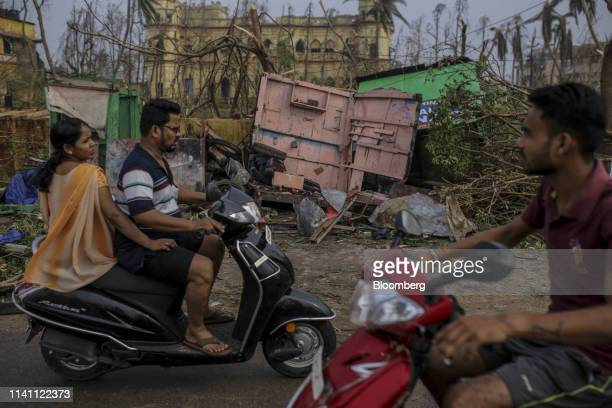 Motorist drive past damaged structures after Cyclone Fani passed through Puri Odisha India on Saturday May 4 2019 A category 4 storm with strong wind...