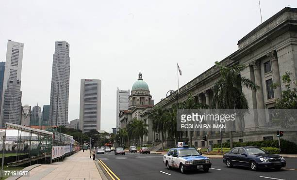 Motorist drive past the city hall which is part of the route for Formula One street circuit in Singapore 25 October 2007. Singapore will hold the...