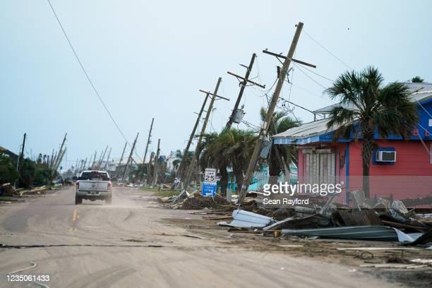 Motorist drives down a road in the wake of Hurricane Ida on September 4, 2021 in Grand Isle, Louisiana. Ida made landfall as a Category 4 hurricane...