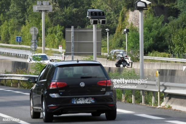 A motorist drives his car next to a new mobile radar in Foix southwestern France on August 23 2017 / AFP PHOTO / PASCAL PAVANI
