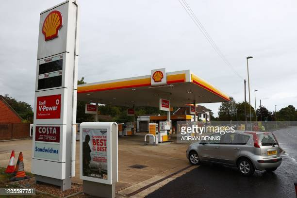 Motorist drives into a closed fuel filling station in Hook, Hampshire on September 30, 2021. - British troops are expected to be deployed within days...