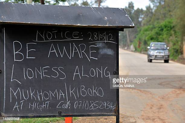 A motorist drives past a notice put up on June 8 2012 outside the main entrance of residential houses in Karen Nairobi's upmarket area The notice was...