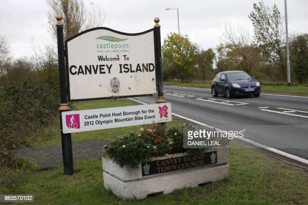 A motorist drives past a welcome sign on Canvey Island Essex on October 20 2017 A small island community in the Thames Estuary that voted massively...