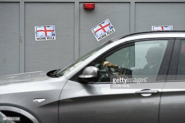 A motorist drives past posters in London on May 1 calling for Home Rule for England AFP PHOTO/Leon Neal