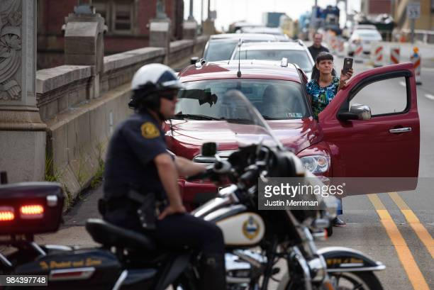 A motorist films a protest a day after the funeral for Antwon Rose II that blocked streets on June 26 2018 in downtown Pittsburgh Pennsylvania Rose...