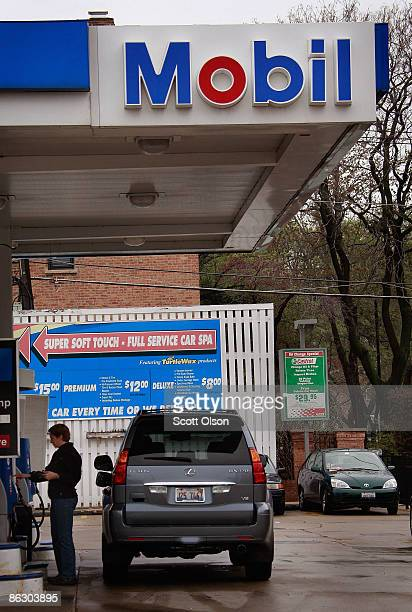 A motorist fuels his car at a Mobil station April 30 2009 in Chicago Illinois Exxon Mobil Corp today reported its lowest profit in five years for the...