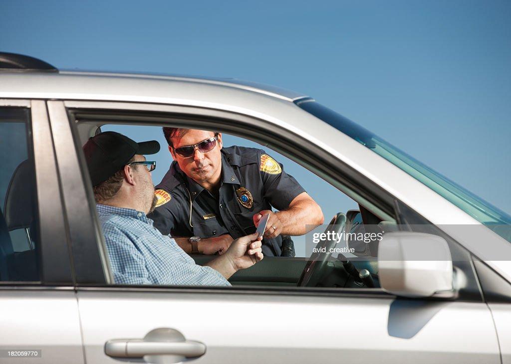 Motorist Handing Police Officer His License : Stock Photo