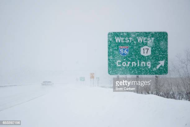 Motorist passes a sign for the route 86 on ramp outside of Binghamton, New York as snow continues to fall on March 14, 2017 in Vestal, New York. A...