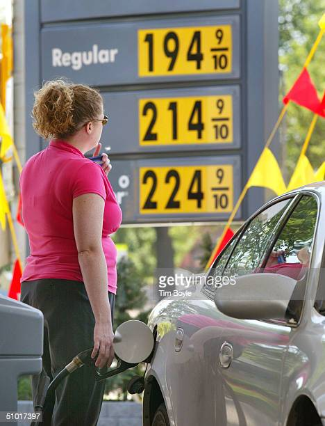 Motorist pumps gas into her car July 1, 2004 in Park Ridge, Illinois. Fuel prices rose for the second day, with price of crude rising $1.90 to $38.95...