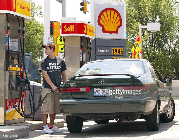 Motorist pumps gas into his car July 1, 2004 in Park Ridge, Illinois. Fuel prices rose for the second day, with price of crude rising $1.90 to $38.95...