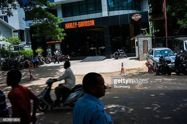A motorist rides past a HarleyDavidson Inc store on Khader Nawaz Khan Road in Chennai Tamil Nadu India on Monday July 21 2014 Optimism about a...