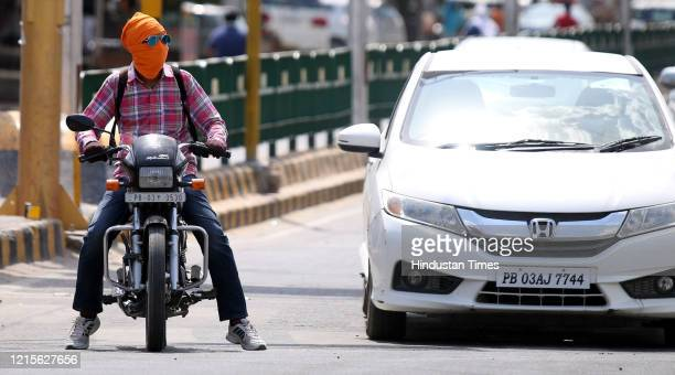 Motorist spotted at Hanuman Chowk with his head wrapped up to protect from the scorching heat on a summer day on May 27, 2020 in Bathinda, India.