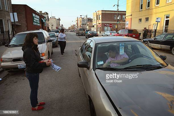 A motorist stops to contribute as Jocelyn Ramos solicits donations to help pay for a funeral for her 14yearold friend Michael Orozco on April 8 2013...