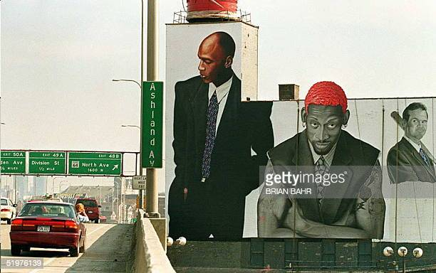 A motorist stops to take a picture of a building painted with a representation of Chicago Bulls basketball players Michael Jordan Dennis Rodman and...