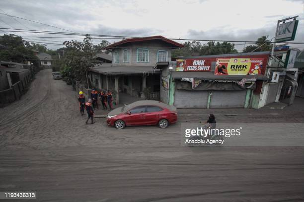Motorist try to cross the road at the town of Agoncillo in Batangas wherein covered in thick blankets of ash due to Taal volcano eruption in Batangas...