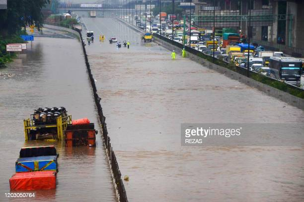 TOPSHOT Motorists are seen trapped on a flooded toll road after heavy rain in Bekasi West Java on February 25 2020 Dozens of Jakarta neighbourhoods...
