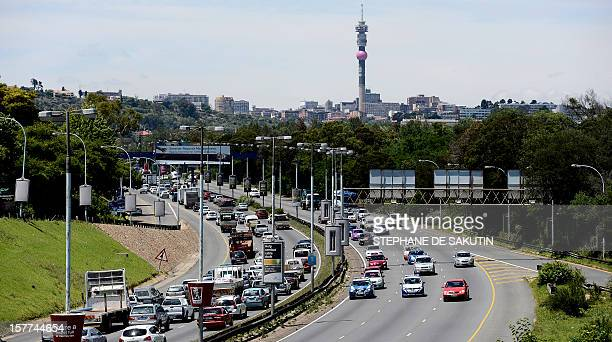 Motorists are stuck in the traffic jam on a motorway on December 6 2012 in Johannesburg The powerful Cosatu labour federation called on December 6...