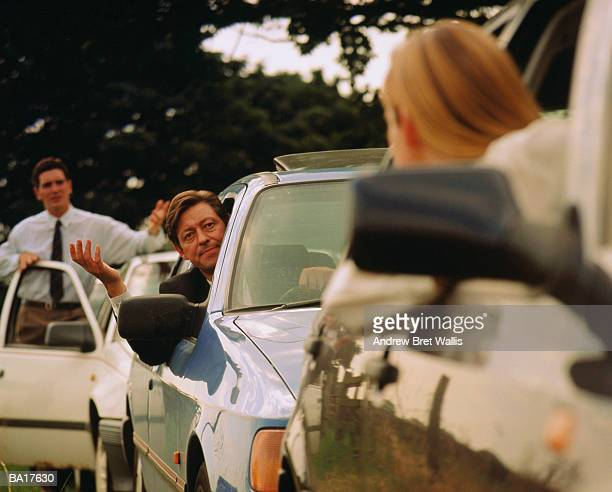 motorists arguing during traffic jam - social issues stock pictures, royalty-free photos & images