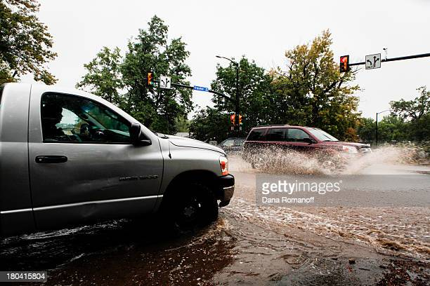 Motorists attempt to drive through downtown Boulder after three days of heavy rainfall September 12 2013 in Boulder Colorado An estimated 610 inches...