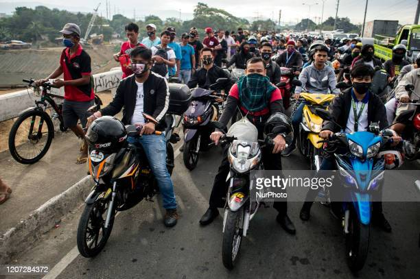 Motorists attempting to cross a border in Quezon City, Philippines pile up in a control point on March 16, 2020. Metro Manila has been under a...