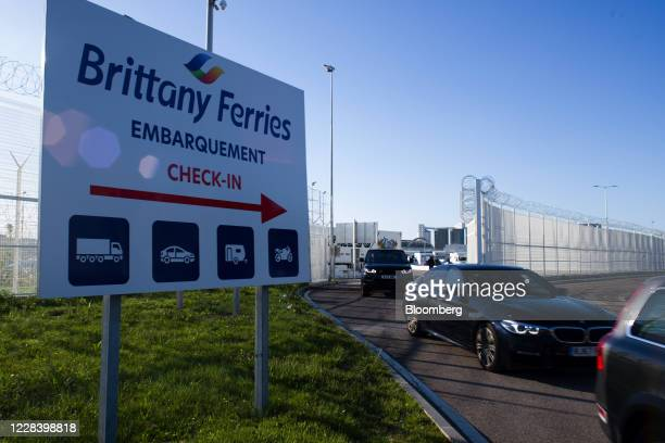 Motorists drive after exiting a Brittany Ferries cross channel ferry, operated by BAI Bretagne Angleterre Irlande SA, arriving from Southampton,...