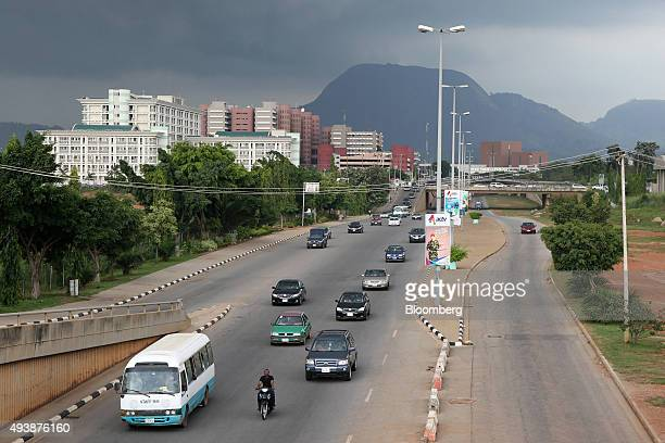 Motorists drive along a highway in Abuja Nigeria on Wednesday Oct 21 2015 A drop in crude prices in the past year has put pressure on public finances...