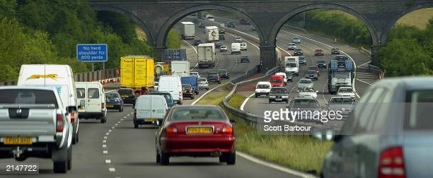 Motorists drive in heavy traffic on the M25 motorway July 9 2003 in London England Britain's Transport Secretary Alistair Darling has announced a...