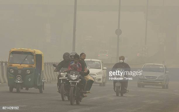 Motorists drive on a major road as smog covers the capital's skyline on November 6 2016 in New Delhi India New Delhi's air quality has steadily...