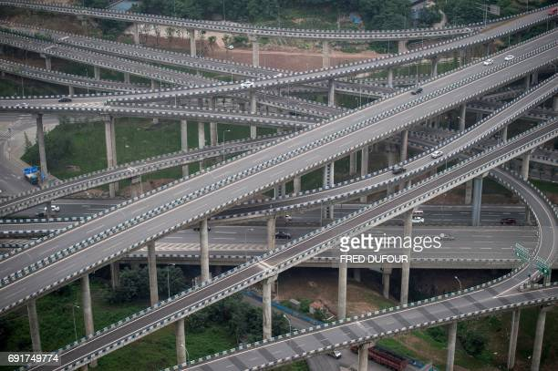 TOPSHOT Motorists drive on an interchange in Chongqing southwest China on June 3 2017 The interchange is made up of five layers 20 ramps and goes in...