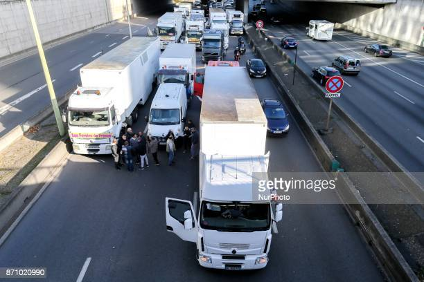 Motorists drive on one lane of the boulevard peripherique in Paris as stallholders block the other side with their trucks during a goslow operation...