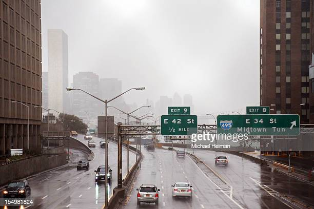 Motorists drive on the FDR Drive along the banks of the East River ahead of Hurricane Sandy on eastside of Manhattan on October 29 2012 in New York...