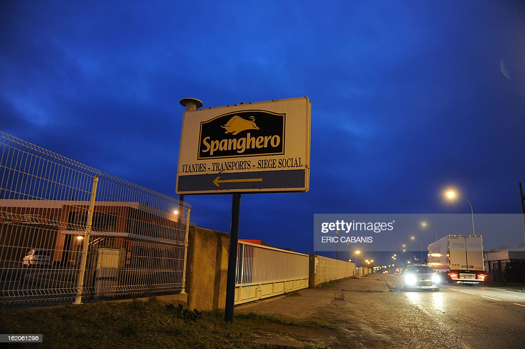 Motorists drive past the Castelnaudary plant of meat-processing firm Spanghero, on February 19, 2013, ahead of the partial resumption of its activities, one day after France renewed its licence that was suspended when it was accused of passing off 750 tonnes of horsemeat as beef. The firm was allowed to produce minced meat, sausages and ready-to-eat meals but not to stock frozen meats.
