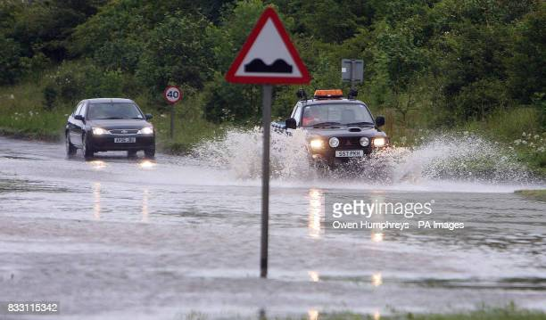 Motorists drive through deep water as heavy rain caused flooding near Beverley in North East Yorkshire