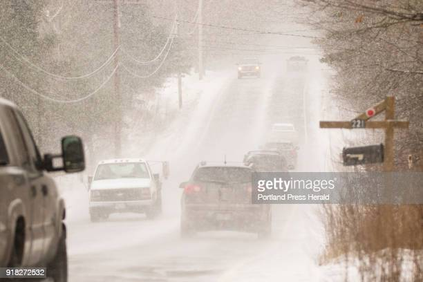 Motorists drive through heavy snow on Rt 22 in Gorham late Friday morning December 22 2017
