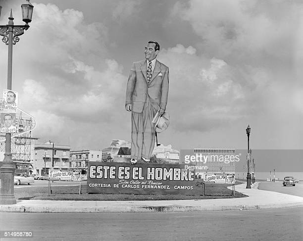 Motorists in Havana were surprised to see a 35 foot figure of Cuba's President Fulgencio Batista smiling down on them from a small park and below the...