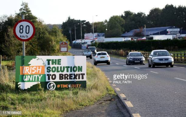 Motorists pass an antiBrexit Irish Unity banner as they drive in Dundalk Ireland on October 16 after crossing the border into Dundalk from Newry in...