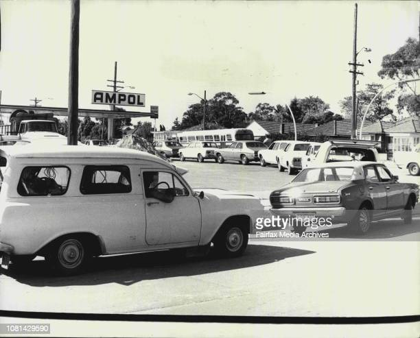 Motorists queue at an Ampol Garage in Burns Bay Rd this afternoon March 29 1974