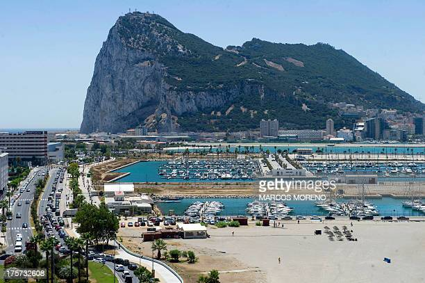 Motorists queue at the border crossing between Spain and Gibraltar in La Linea de la Concepcion on August 7 2013 Gibraltar on August 5 blasted a...