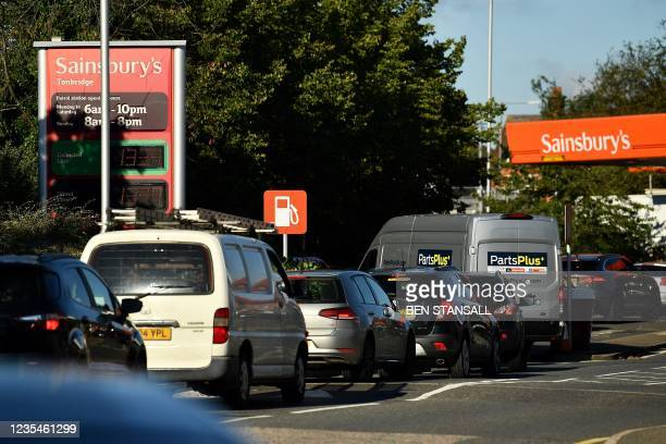 Motorists queue for petrol at a Sainsbury's service station in Tonbridge, southeast England on September 24, 2021. - The UK government today urged...