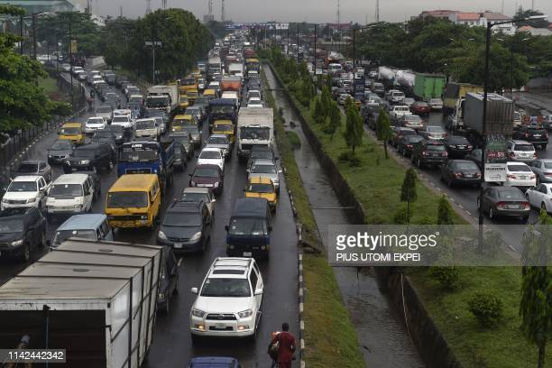 Motorists queue in a chaotic traffic gridlock following downpours at Ojota district of Lagos Ibadan expressway on May 9 2019 Lagos residents are...