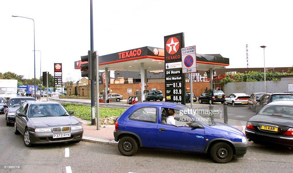 Motorists queue on to a main road outside a Texaco petrol