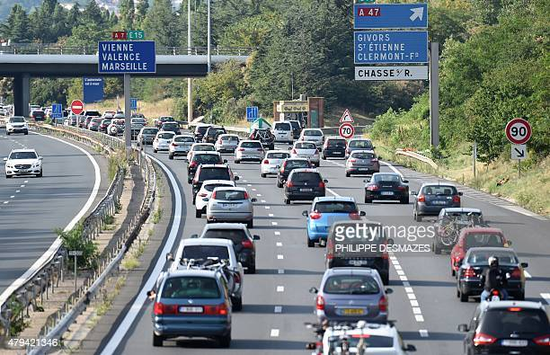 Motorists queue up in traffic on the A7 motorway on July 4 2015 between Lyon and Vienne centraleastern France on the first weekend of the annual...